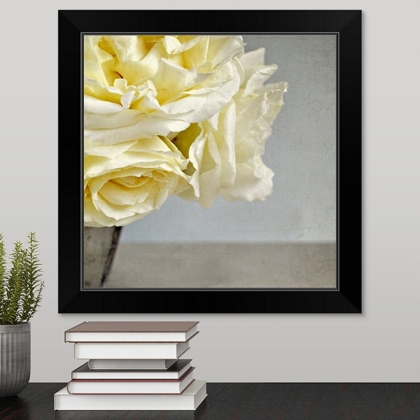 """Cream vanilla roses in silver vase against Grey/blue background."" Black Framed Print"