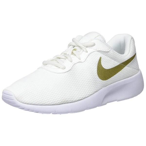 Shop Nike Boys' Tanjun (Bg) Trainers, (Summit Metallic Gold