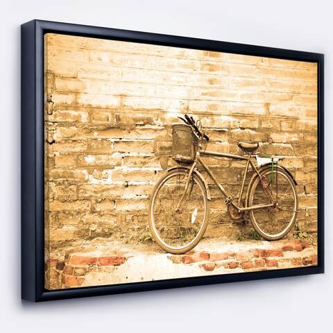 Designart 'Vintage Bicycle against Brown Wall' Landscape Art Print Framed Canvas