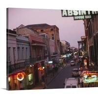Premium Thick-Wrap Canvas entitled Store signs lit up at dusk, Bourbon Street, New Orleans, LA - Multi-color