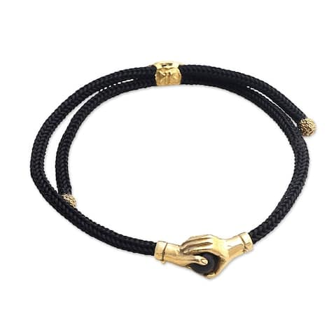 NOVICA Golden Handshake, Brass and obsidian unity bracelet
