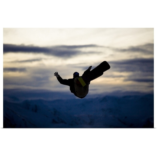 """""""A male snowboarder does a back flip while riding at a snow park in Wanaka, New Zealand."""" Poster Print"""