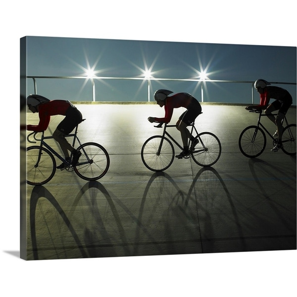 """""""Cyclists on velodrome track at night, side view"""" Canvas Wall Art"""