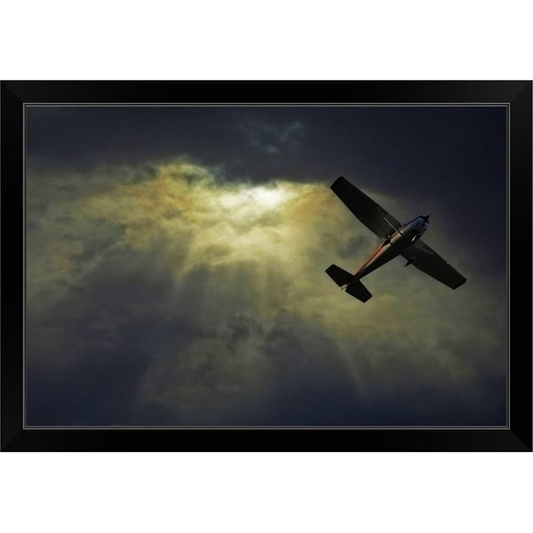 """Image of an airplane flying over sunset sky."" Black Framed Print"