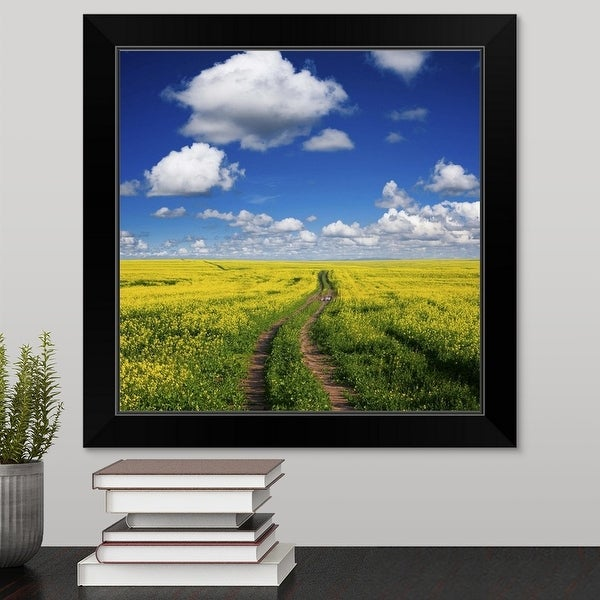 """Wide angle view of tracks in a canola field"" Black Framed Print"