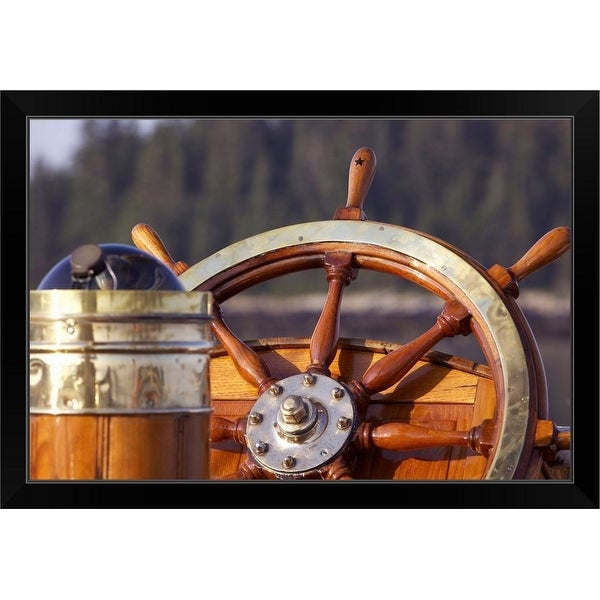 """A warm glow highlights the ship's wheel and compass on a classic sailing yacht"" Black Framed Print"