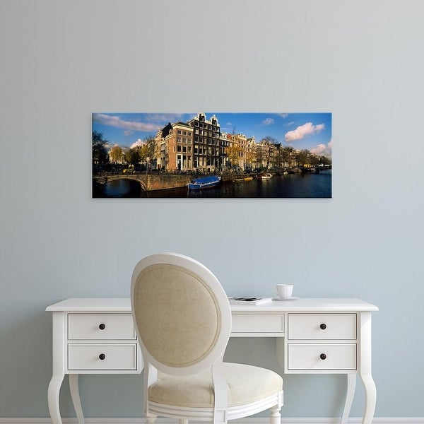 Easy Art Prints Panoramic Images's 'Buildings along a canal, Amsterdam, Netherlands' Premium Canvas Art