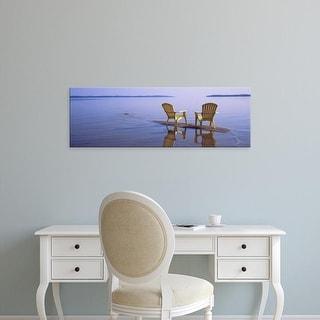 Easy Art Prints Panoramic Image 'Reflection of two adirondack chairs in a lake, Lake Michigan, Michigan' Canvas Art