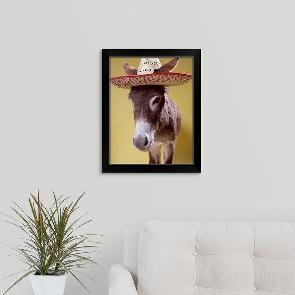 """Donkey (Equus hemonius) wearing straw hat"" Black Framed Print"