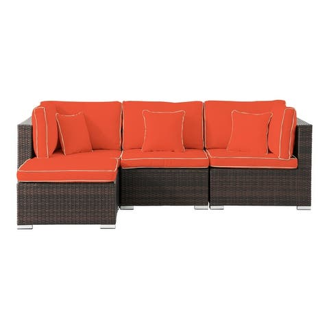 Carrington 4-piece Rattan Sectional Seating Group with Cushions and Accent Pillow