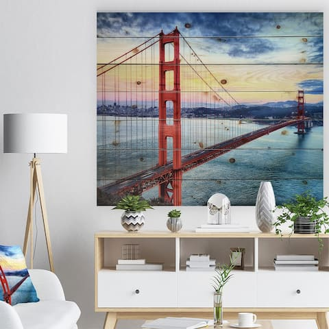 Designart 'Golden Gate Bridge in San Francisco' Sea Bridge Print on Natural Pine Wood - Blue
