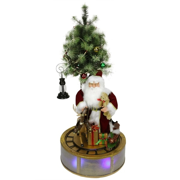 4' Animated and Musical Lighted LED Santa Claus with Tree and Rotating Train Christmas Decor - RED