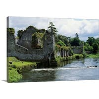 Premium Thick-Wrap Canvas entitled Moat around castle ruins, Ireland.