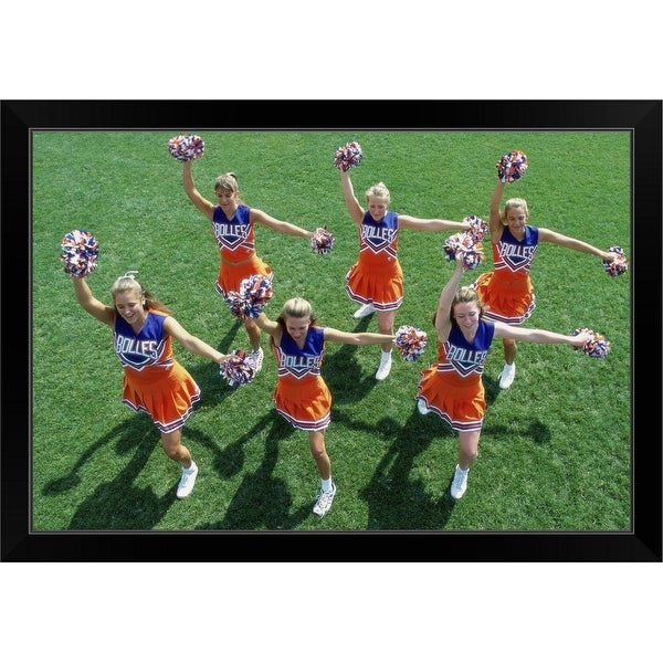 """High angle view of a group of cheerleaders cheering in a field"" Black Framed Print"
