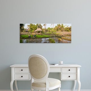 Easy Art Prints Panoramic Images's 'Farmer working in a rice field, Chiang Mai, Thailand' Premium Canvas Art