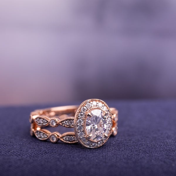 Miadora 1 1/2ct DEW Oval-cut Moissanite Halo Vintage Bridal Ring Set in 10k Rose Gold. Opens flyout.