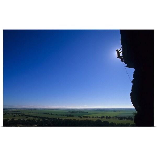 """Silhouette of man rock climbing"" Poster Print"
