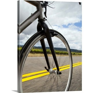 """Link to """"Man road biking at high speed"""" Canvas Wall Art Similar Items in Cycling Equipment"""