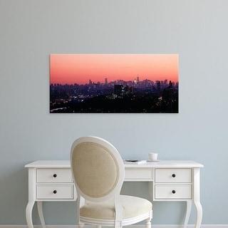 Easy Art Prints Panoramic Image 'View of buildings lit up, Manhattan, New York City, New York, USA' Canvas Art