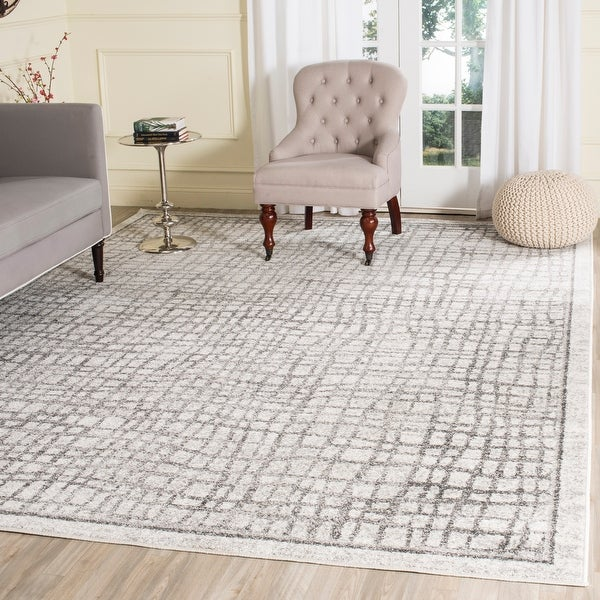 Safavieh Adirondack Abstract Grid Distressed Rug. Opens flyout.