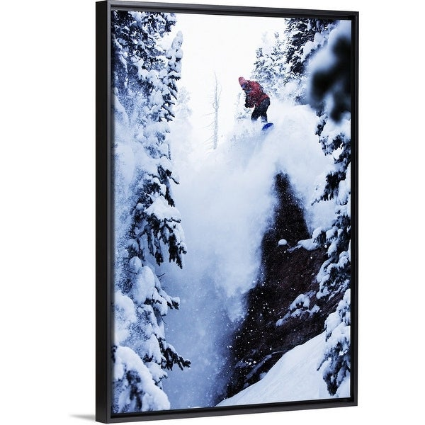 26553bcef Shop A snowboarder jumping off a cliff in the backcountry in ...