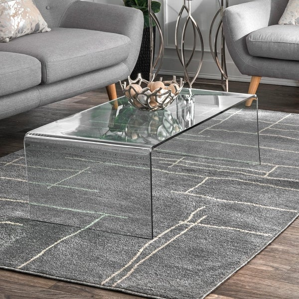 Strick & Bolton Finley Grey Graphic Area Rug. Opens flyout.
