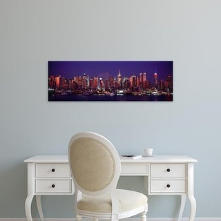Easy Art Prints Panoramic Image 'Buildings lit up at dusk, Manhattan, New York City, New York State, USA' Canvas Art