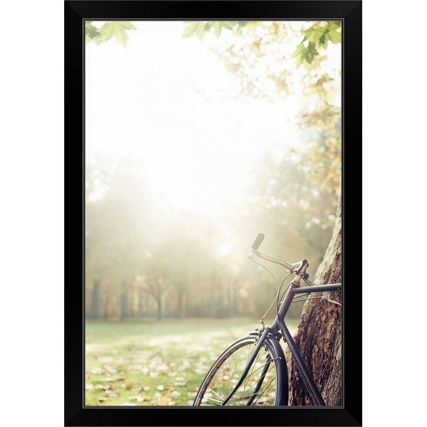 """Bicycle leaned on tree in autumn light."" Black Framed Print"