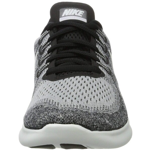 grey and white nike running shoes