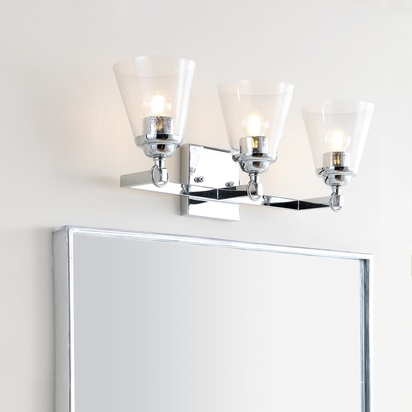 """Marion 21"""" 3-light Hurricane Metal/Glass Vanity Light, Chrome by JONATHAN Y. Opens flyout."""