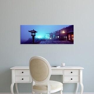 Easy Art Prints Panoramic Image 'Buildings lit up at night, Mount Taishan, Shandong Province, China' Premium Canvas Art