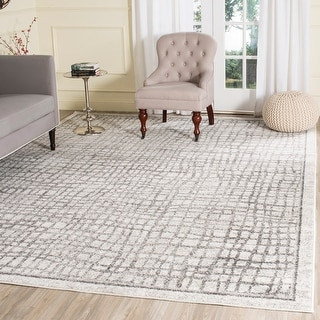 Link to Safavieh Adirondack Abstract Grid Distressed Rug Similar Items in Accent Chairs