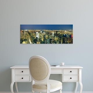 Easy Art Prints Panoramic Image 'View Of Buildings Lit Up, Manhattan, NYC, New York City, New York, USA' Canvas Art