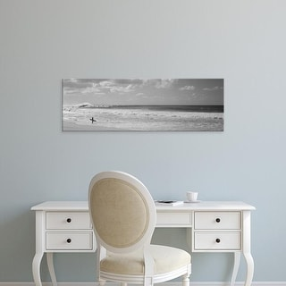 Easy Art Prints Panoramic Images's 'Surfer standing on the beach, North Shore, Oahu, Hawaii, USA' Premium Canvas Art