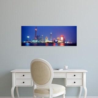 Easy Art Prints Panoramic Images's 'Buildings lit up at dusk, Shanghai, China' Premium Canvas Art