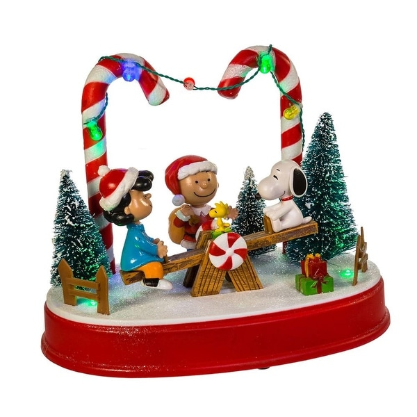 875 vibrantly colored peanuts musical animated christmas themed table piece green - Musical Animated Christmas Decorations