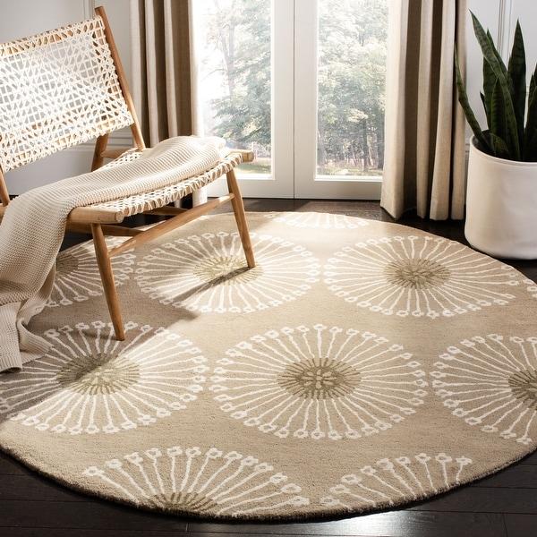 SAFAVIEH Handmade Soho Sagita Dandelion N.Z. Wool Rug. Opens flyout.