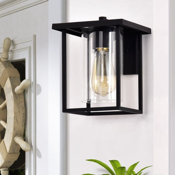 1-light 7-in./ 9.5-in. Outdoor Black Metal Wall Sconce w/ Clear Glass Shade. Opens flyout.