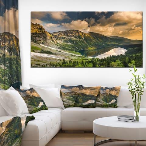 Designart 'Dramatic Sky over Alpine Lake' Landscape Canvas Art Print