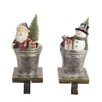 "Pack of 2 of an Assortment of 2 Santa Claus and Snowman Stocking Holders 8""H"