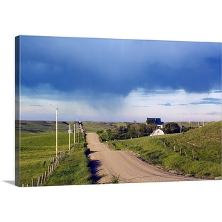 """Dirt road through hilly farmland, distant storm, Missouri Breaks, Montana"" Canvas Wall Art"
