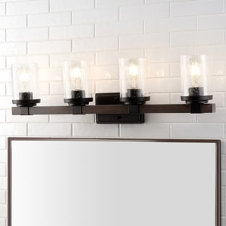 Link to Bungalow Iron/Seeded Glass Rustic Farmhouse LED Vanity Light, Oil Rubbed Bronze  by JONATHAN  Y Similar Items in Sconces