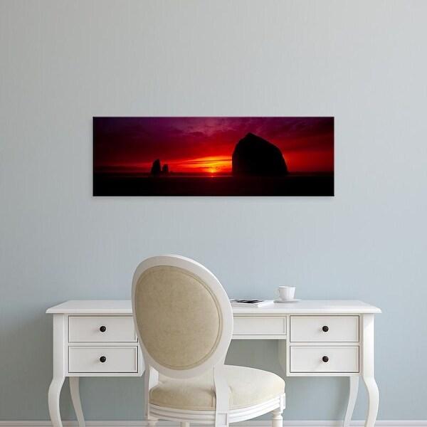 Easy Art Prints Panoramic Image 'Silhouette of rocks, Haystack Rock, Cannon Beach, Clatsop County, Oregon' Canvas Art