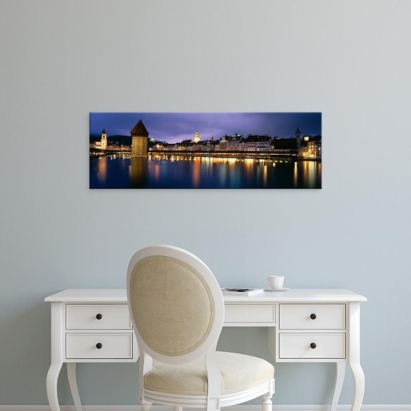 Easy Art Prints Panoramic Image 'Buildings lit up at dusk, Chapel Bridge, Reuss River, Lucerne, Switzerland' Canvas Art