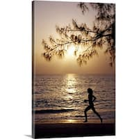 Premium Thick-Wrap Canvas entitled Runner on Seven Mile Beach, Grand Cayman