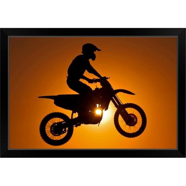 """Silhouette of motocross race in mid air at sunset."" Black Framed Print"
