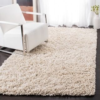 Link to Safavieh Handmade Sheep Shag Solid Polyester Rug Similar Items in Shag Rugs