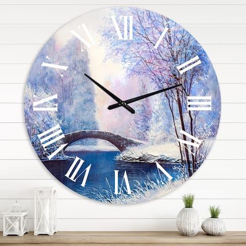 Designart 'Winter Scenery With Bridge Of Meandering River III' Lake House wall clock