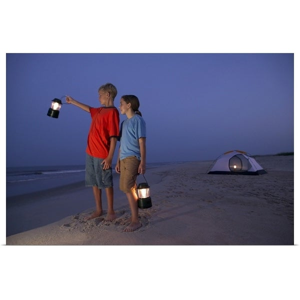 """A boy and a girl stand with lanterns on the beach with a tent in the background"" Poster Print"