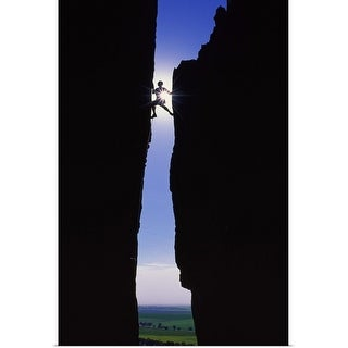 """""""Silhouette of man rock climbing with starburst"""" Poster Print"""